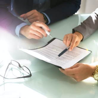 Two professionals reviewing a contract